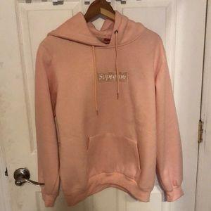 Supreme box logo light pink hoodie .